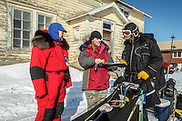 Nathan Schroeder signs in at the Nulato checkpoint on Saturday March 12th during the 2016 Iditarod.  Alaska    <br /> <br /> Photo by Jeff Schultz (C) 2016  ALL RIGHTS RESERVED