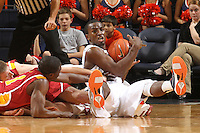 Dec. 30, 2010; Charlottesville, VA, USA; Virginia Cavaliers guard K.T. Harrell (24) calls time out after wrestling for a loose ball with Iowa State Cyclones guard Bubu Palo (1) and Iowa State Cyclones forward Jamie Vanderbeken (23) during the game at the John Paul Jones Arena. Iowa State Cyclones won 60-47. Mandatory Credit: Andrew Shurtleff-