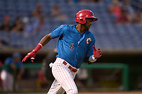 Clearwater Threshers Carlos De La Cruz (6) runs to first base during a game against the Dunedin Blue Jays on May 18, 2021 at BayCare Ballpark in Clearwater, Florida.  (Mike Janes/Four Seam Images)