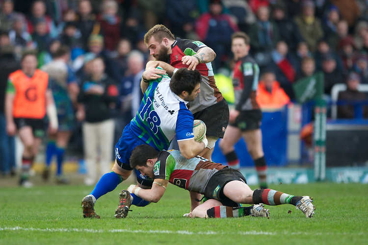 Ronan Loughney of Connacht Rugby is tackled by Joe Marler (right) and   Tom Casson of Harlequins during the Heineken Cup match between Harlequins and Connacht Rugby at The Twickenham Stoop on Saturday 12th January 2013 (Photo by Rob Munro).