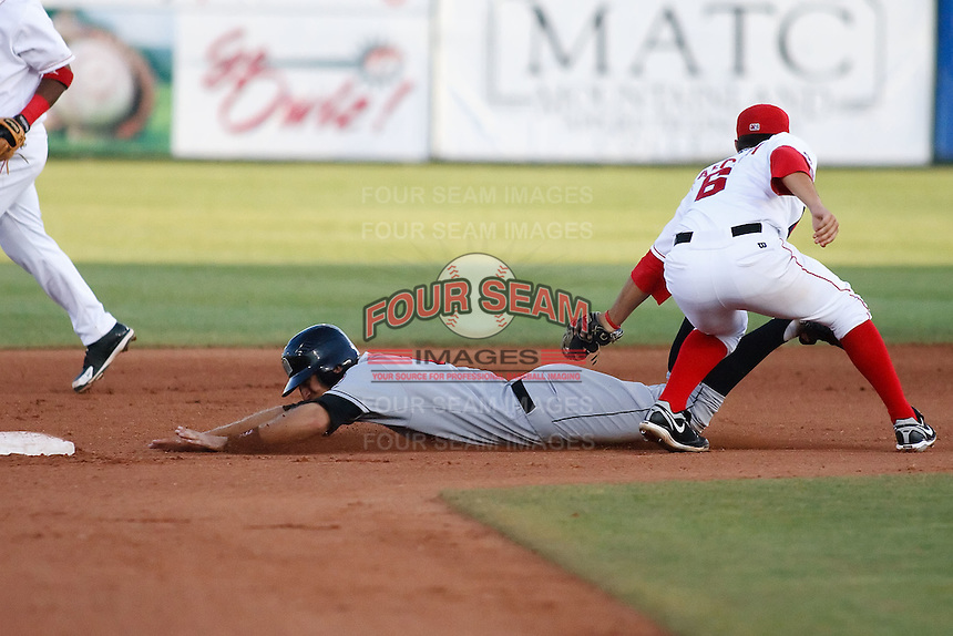 July 10, 2009: Jon Karcich 2009 7th round draft pick of the Orem Owlz, Rookie Class-A affiliate of the Los Angeles Angels of Anaheim, during a game at the Orem Owlz Ballpark in Orem, UT. Photo by: Matthew Sauk/Four Seam Images
