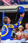 HALLANDALE BEACH, FLORIDA - APRIL 2:  Photo Call #4, ridden by Jockey Javier Castellano, raising his helmet in victory, after winning the 56th Running of The Orchid at Gulfstream Park on April 2, 2016 in Hallandale Beach, Florida (photo by Doug DeFelice/Eclipse Sportswire/Getty Images)