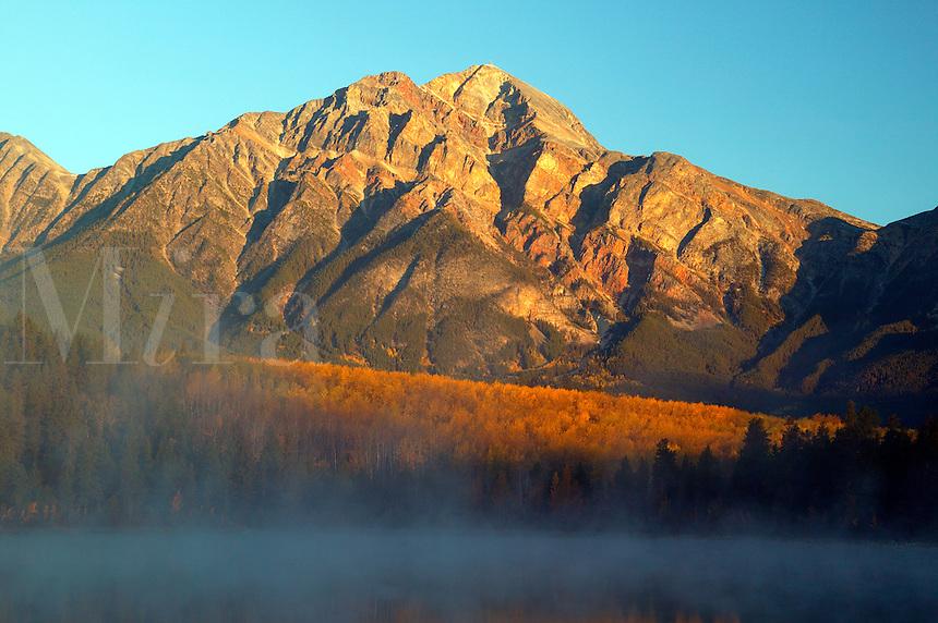 Pyramid Mountain and Patricia Lake during a foggy fall sunrise, Jasper National Park, Alberta, Canada.