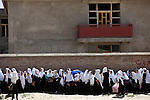 """15 June 2013, Dari Cha Noor School, Qargha, Kabul Province,  Afghanistan. School students line up at the Dari Cha Noor (""""Window to Knowledge"""") School. The school has begun to formulate plans to improve and expand under the  Education Quality Improvement Program (EQUIP). Currently they have only organised the shura council but already they have enrolled another 75 students in the last three months. The school will benefit from the EQUIP whose objective is to increase access to quality basic education, especially for girls. School grants and teacher training programs are strengthened by support from communities and private providers.  Picture by Graham Crouch/World Bank"""