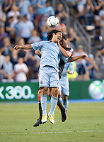 Branko Boskovic (8) of D.C. United goes up for a header with Roger Espinoza (15) of Sporting Kansas City during the game at Livestrong Sporting Park in Kansas City, Kansas.  D.C. United lost to Sporting Kansas City, 1-0.