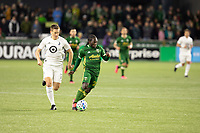 PORTLAND, OR - MARCH 01: Diego Chara #21 of the Portland Timbers dribbles away from Robin Lod #17 of Minnesota United during a game between Minnesota United FC and Portland Timbers at Providence Park on March 01, 2020 in Portland, Oregon.