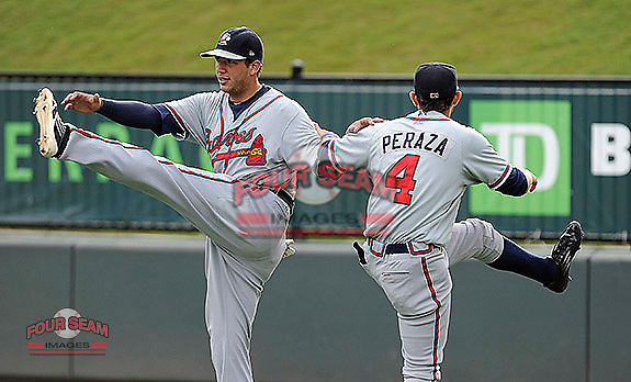 Edison Sanchez (2), left, and Jose Peraza (4) of the Rome Braves stretch together before a game against the Greenville Drive on Tuesday, August 20, 2013, at Fluor Field at the West End in Greenville, South Carolina. Rome won, 4-2. (Tom Priddy/Four Seam Images)