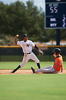 New York Yankees shortstop Jose Devers (4) turns a double play as Tristan Graham (43) slides into second base during an Instructional League game against the Baltimore Orioles on September 23, 2017 at the Yankees Minor League Complex in Tampa, Florida.  (Mike Janes/Four Seam Images)