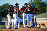 Batavia Muckdogs starting pitcher Ryan McKay (27) listens to pitching coach Chad Rhoades (15) as Javier Lopez (23), Garvis Lara (34), Rony Cabrera (26), Joseph Chavez (22) and Pablo Garcia (7) listen in during a game against the State College Spikes on June 23, 2016 at Dwyer Stadium in Batavia, New York.  State College defeated Batavia 8-4.  (Mike Janes/Four Seam Images)