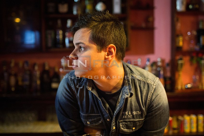 Bruno has two masters degrees but is still applying to the Navy because it would provide the most stable income. In the meantime, he has worked a myriad of part time jobs, including as a bartender. Ferrol, Spain.
