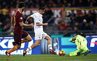 Calcio, Serie A: Roma vs Milan. Roma, stadio Olimpico, 12 dicembre 2016.<br /> Milan's Gianluca Lapadula, center, chased by Roma's Federico Fazio, is fouled by goalkeeper Wojciech Szczesny during the Italian Serie A football match between Roma and AC Milan at Rome's Olympic stadium, 12 December 2016.<br /> UPDATE IMAGES PRESS/Isabella Bonotto