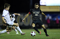 WINSTON-SALEM, NC - DECEMBER 07: Bruno Lapa #10 of Wake Forest University is fouled by Sam Fletcher #30 of the University of California Santa Barbara during a game between UC Santa Barbara and Wake Forest at W. Dennie Spry Stadium on December 07, 2019 in Winston-Salem, North Carolina.