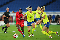 YOKOHAMA, JAPAN - AUGUST 6: Nichelle Prince #15 of Canada and Amanda Ilestedt #13 of Sweden battle for the ball during a game between Canada and Sweden at International Stadium Yokohama on August 6, 2021 in Yokohama, Japan.