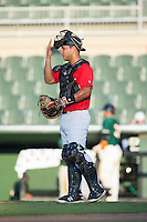 Kannapolis Intimidators catcher Daniel Gonzalez (23) gives signs to the defense during the game against the Greensboro Grasshoppers at Intimidators Stadium on July 17, 2016 in Greensboro, North Carolina.  The Grasshoppers defeated the Intimidators 5-4 in game two of a double-header.  (Brian Westerholt/Four Seam Images)