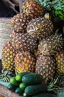 Tanzania.  Mto wa Mbu.  Pineapples and Cucumbers in the Market.