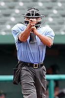 Home plate umpire Carlos Martinez makes a call during a game between the Kane County Cougars and South Bend Silver Hawks at Coveleski Stadium on July 24, 2011 in South Bend, Indiana.  Kane County defeated South Bend 7-5.  (Mike Janes/Four Seam Images)