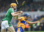 Podge Collins of Clare in action against Ritchie English of Limerick during their Munster championship game in Ennis. Photograph by John Kelly.