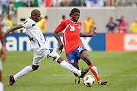 Oscar Garcia (14) of Honduras defends a pass from Dennis Marshall (20) of Costa Rica. Honduras defeated Costa Rica on penalty kicks after playing to a 1-1 tie during a quarterfinal match of the 2011 CONCACAF Gold Cup at the New Meadowlands Stadium in East Rutherford, NJ, on June 18, 2011.
