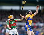 Padraig Ward of Clooney-Quin in action against Jamie Shanahan of  Sixmilebridge during their senior county final replay at Cusack park. Photograph by John Kelly.
