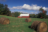 AJ4552, autumn, Vermont, Hay bales in green field with red barn and blue sky with puffy white clouds in the fall in Peacham in Caledonia County in the state of Vermont.