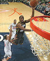 CHARLOTTESVILLE, VA- DECEMBER 6: Jonathan Arledge #5 of the George Mason Patriots shoots the ball over Malcolm Brogdon #22 of the Virginia Cavaliers during the game on December 6, 2011 at the John Paul Jones Arena in Charlottesville, Virginia. Virginia defeated George Mason 68-48. (Photo by Andrew Shurtleff/Getty Images) *** Local Caption *** Jonathan Arledge;Malcolm Brogdon