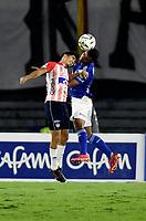 BOGOTA - COLOMBIA, 23-10-2021: Omar Bertel de Millonarios y Fabian Sambueza de Atletico Junior disputan el balon durante partido entre Millonarios F. C. y Atletico Junior de la fecha 15 por la Liga BetPlay DIMAYOR II 2021 jugado en el estadio Nemesio Camacho El Campin de la ciudad de Bogota. / Omar Bertel of Millonarios F. C. and Fabian Sambueza of Atletico Junior figth for the ball during a match between Millonarios F. C. and Atletico Junior of the 15th date for the BetPlay DIMAYOR II 2021 League played at the Nemesio Camacho El Campin Stadium in Bogota city. / Photo: VizzorImage / Luis Ramirez / Staff.