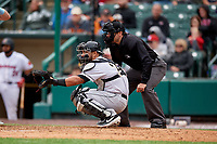 Charlotte Knights catcher Daniel Gonzalez (29) and umpire Mike Wiseman during an International League game against the Rochester Red Wings on June 16, 2019 at Frontier Field in Rochester, New York.  Rochester defeated Charlotte 3-2 in the second game of a doubleheader.  (Mike Janes/Four Seam Images)
