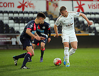 Pictured: Stephen Kingsley of Swansea (R) Monday 04 April 2016<br />Re: Swansea City AFC U21 v Newcastle United FC U21 at the Liberty Stadium, Swansea, UK