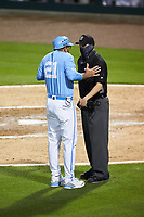 North Carolina Tar Heels head coach Scott Forbes (21) argues a call with home plate umpire Kevin Sweeney during the game against the South Carolina Gamecocks at Truist Field on April 6, 2021 in Charlotte, North Carolina. (Brian Westerholt/Four Seam Images)