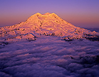 Aerial of Mount Rainier with sunset lighting, Washington State.