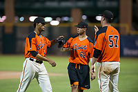 AZL Giants relief pitcher Olbis Parra (72) is congratulated by Deiyerbert Bolivar (62) and John Gavin (57) between innings during Game Three of the Arizona League Championship Series against the AZL Cubs on September 7, 2017 at Scottsdale Stadium in Scottsdale, Arizona. AZL Cubs defeated the AZL Giants 13-3 to win the series two games to one. (Zachary Lucy/Four Seam Images)
