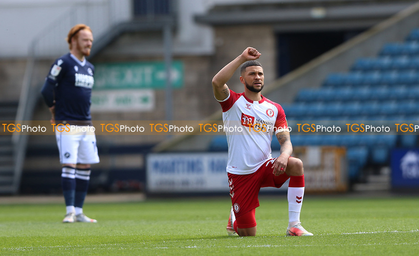 Nahki Wells of Bristol City takes the knee and raises his hand during Millwall vs Bristol City, Sky Bet EFL Championship Football at The Den on 1st May 2021