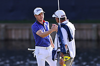 14th March 2021; Ponte Vedra Beach, Florida, USA;  Justin Thomas of the United States shakes hands with caddie Jimmy Johnson on the 18th hole during the final round of THE PLAYERS Championship on March 14, 2021 at TPC Sawgrass Stadium Course in Ponte Vedra Beach, Fl.
