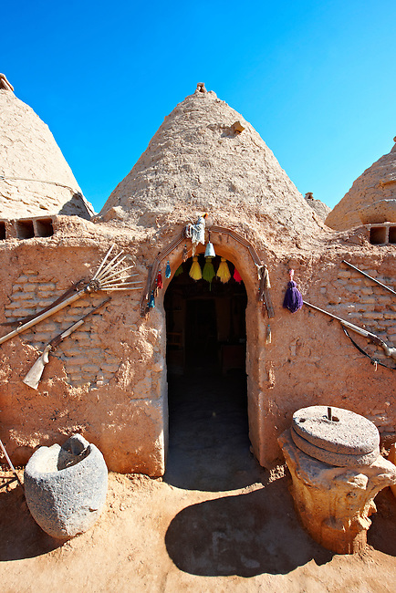 """Pictures of the beehive adobe buildings of Harran, south west Anatolia, Turkey.  Harran was a major ancient city in Upper Mesopotamia whose site is near the modern village of Altınbaşak, Turkey, 24 miles (44 kilometers) southeast of Şanlıurfa. The location is in a district of Şanlıurfa Province that is also named """"Harran"""". Harran is famous for its traditional 'beehive' adobe houses, constructed entirely without wood. The design of these makes them cool inside. 14"""