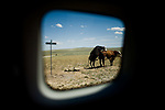 Travel Scenes from Wyoming through the window of a rented Mazda M5.