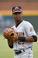 Right fielder Isiah Gilliam (25) of the Charleston RiverDogs warms up prior to a game against the Greenville Drive on Thursday, July 27, 2017, at Fluor Field at the West End in Greenville, South Carolina. Charleston won, 5-2. (Tom Priddy/Four Seam Images)