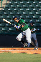 Adrian Abreu (24) of the Savannah Sand Gnats follows through on his swing against the Hickory Crawdads at L.P. Frans Stadium on June 14, 2015 in Hickory, North Carolina.  The Crawdads defeated the Sand Gnats 8-1.  (Brian Westerholt/Four Seam Images)