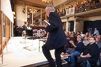 """Der rechte SPD-Populist Thilo Sarrazin sollte am Sonntag den 2. Maerz 2014 auf Einladung des Politmagazin Cicero im Berliner Ensemble sein umstrittenes Buch """"Der Neue Tugendterror - Ueber die Grenzen der Meinungsfreiheit in Deutschland"""" vorstellen. Ca. 300 Menschen protestierten davor gegen seinen Auftritt in dem von Berthold Brecht gegruendeten Theater.<br />Etwa 20 Personen von Antirassitischen Gruppen gelang es im Publikum Platz zu nehmen. Mit Einmarsch von Sarrazin riefen sie laut Parolen gegen den ihrer Meinung nach Rassisten und hielten Plakate hoch. Anhaenger Sarrazins gingen zum Teil handgreiflich auf die Protestierer los. Die Veranstaltung musste nach ca. 30 Minuten abgebrochen werden ohne das Sarrazin eine seiner Thesen vortragen konnte.<br />Im Bild: Sarrazin betritt den Saal.<br />2.3.2014, Berlin<br />Copyright: Christian-ditsch.de<br />[Inhaltsveraendernde Manipulation des Fotos nur nach ausdruecklicher Genehmigung des Fotografen. Vereinbarungen ueber Abtretung von Persoenlichkeitsrechten/Model Release der abgebildeten Person/Personen liegen nicht vor. NO MODEL RELEASE! Don't publish without copyright Christian-Ditsch.de, Veroeffentlichung nur mit Fotografennennung, sowie gegen Honorar, MwSt. und Beleg. Konto:, I N G - D i B a, IBAN DE58500105175400192269, BIC INGDDEFFXXX, Kontakt: post@christian-ditsch.de Urhebervermerk wird gemaess Paragraph 13 UHG verlangt.]"""