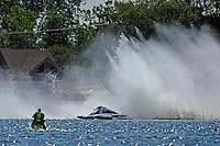 """Frame 4: Kevin Kreitzer, A-64 """"Blue Devil"""" hooks in turn 2 and blows some decking off the boat. (2.5 MOD class hydroplane(s)"""
