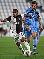 Calcio, Serie A: Juventus - Lazio, Allianz Stadium, July 20, 2020.<br /> Juventus' Douglas Costa (l) in action with Lazio's Sergej Milinkovic-Savic (r)during the Italian Serie A football match between Juventus and Lazio at the Allianz stadium in Turin, July 20, 2020.<br /> UPDATE IMAGES PRESS/Isabella Bonotto