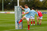 Kyle Whyte of London Scottish warms up during the Championship Cup match between London Scottish Football Club and Nottingham Rugby at Richmond Athletic Ground, Richmond, United Kingdom on 28 September 2019. Photo by Carlton Myrie / PRiME Media Images