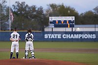 Calvary Christian Warriors pitcher Tyler Dietz (21) and catcher Eli Kapkowski (34) stand for the national anthem before a game against the Lakeland Christian Vikings on February 27, 2021 at Calvary Christian High School in Clearwater, Florida.  (Mike Janes/Four Seam Images)