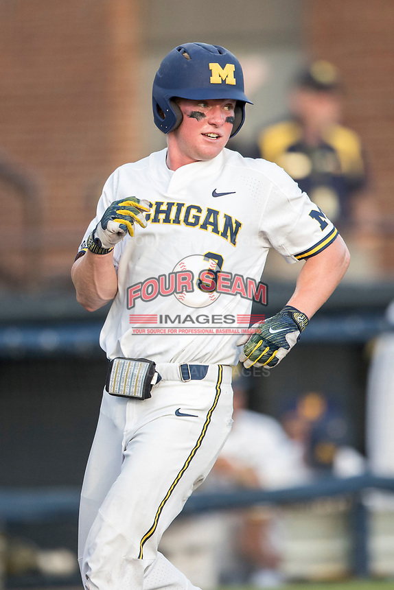 Michigan Wolverines outfielder Miles Lewis (3) scores during the NCAA baseball game against the Eastern Michigan Eagles on May 16, 2017 at Ray Fisher Stadium in Ann Arbor, Michigan. Michigan defeated Eastern Michigan 12-4. (Andrew Woolley/Four Seam Images)