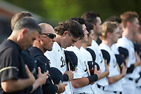 Bobby Seymour (3) of the Wake Forest Demon Deacons bows his head during the National Anthem prior to the game against the North Carolina State Wolfpack at David F. Couch Ballpark on April 18, 2019 in  Winston-Salem, North Carolina. The Demon Deacons defeated the Wolfpack 7-3. (Brian Westerholt/Four Seam Images)
