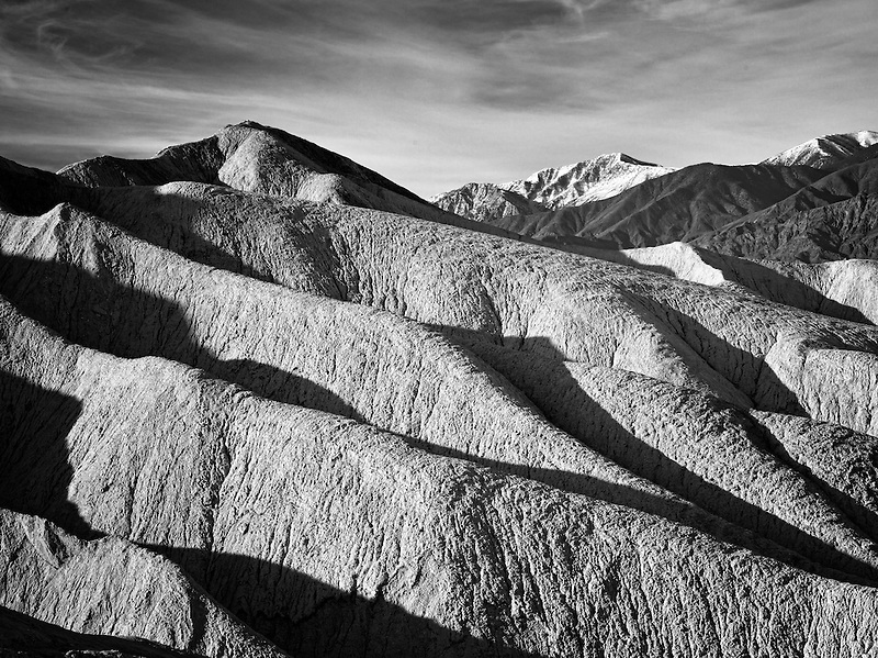 Rock formations and snow covered Telescope Peak from Golden Canyon Trail. Death Valley National Park, California