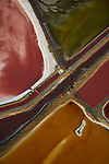 Pictured:  As water evaporates under the hot sun, these salt ponds are transformed into a beautiful patchwork of deep, earthy colours at  San Francisco, California, USA. <br /> <br /> Amazing aerial photos show off the majesty of America's landscape, its architecture, its industry and its wildlife.   From the startling blue potash pools of Utah to hundreds of aircraft sitting unused due to the pandemic, the images display a little seen side of the USA.<br /> <br /> Other images include a passenger plane plane as it touches down in California taken 4,500ft above it, fog over the Golden Gate Bridge and a solar farm in Nevada.   Professor of Music Jassen Todorov, from San Francisco, captured the striking pictures of the American West while flying in a light aircraft.   SEE OUR COPY FOR DETAILS<br /> <br /> Please byline: Jassen Todorov/Solent News<br /> <br /> © Jassen Todorov/Solent News & Photo Agency<br /> UK +44 (0) 2380 458800