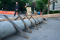 A homemade barricade lines the street near Lafayette Square across from the White House in Washington D.C., U.S., on Tuesday, June 23, 2020, after police tried to open the street to traffic Monday night.  Credit: Stefani Reynolds / CNP/AdMedia