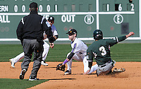 John Matrinez (3) of the Michigan State Spartans steals second safely as Anthony Freschet (4) of the Northwestern Wildcats takes the throw on Sunday, February 17, 2013, at Fluor Field at the West End in Greenville, South Carolina. (Tom Priddy/Four Seam Images)