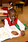 K-8 Parochial School Bronx New York Kindergarten students writing in math workbooks vertical