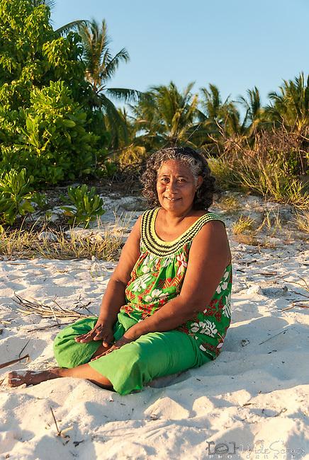 A portrait of a local i-kiribati woman on the beach at sunset on Kiritimati in Kiribati